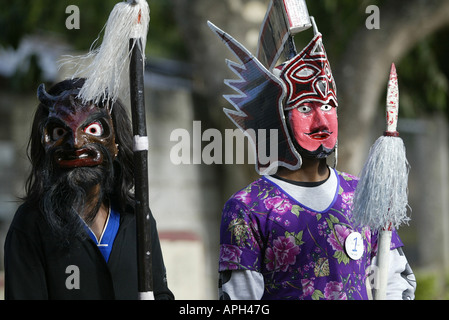 Filipino's portray Satan and a Roman soldier during Good Friday in Mansalay, Oriental Mindoro, Philippines. - Stock Photo