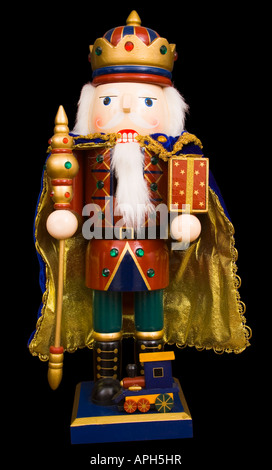 A traditional Christmas nutcracker ornament isolated on black - Stock Photo