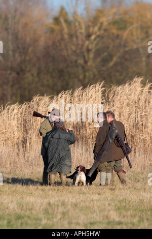Sooting party standing talking Fen Drayton - Stock Photo