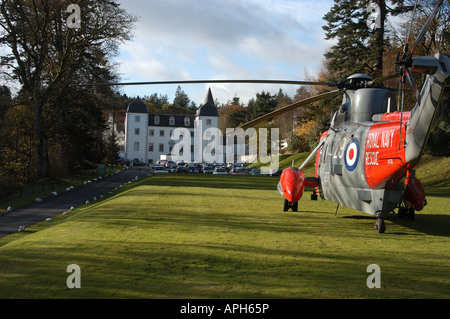 Royal Navy Search and Rescue SAR Sea King helicopter landed at Barony Castle, Peebleshire, Scotland - Stock Photo
