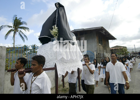 Filipinos carry an effigy of the Virgin Mary through the streets of Mansalay, Oriental Mindoro, Philippines, during - Stock Photo