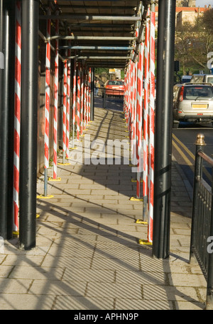 Walkway under scaffolding. scaffolding or similar structures. Road engineering people.Health and Safety. - Stock Photo