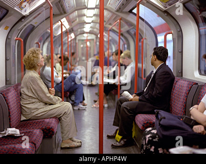 tube journey with people travelling in london - Stock Photo