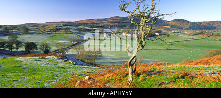 A cold frosty panoramic winter landscape looking down on Orchardton Tower with Screel hill behind Dumfries and Galloway - Stock Photo