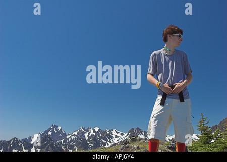 Teen hiker on ridge in Olympic Mountains - Stock Photo