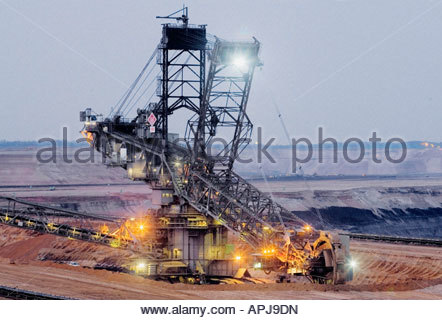 Bucket wheel excavator in brown coal open pit - Stock Photo