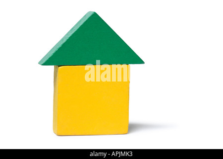 Blocks stacked up in the shape of a house. - Stock Photo