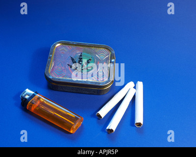 cigarettes, lighter and cigarette box with cannabis leaf - Stock Photo