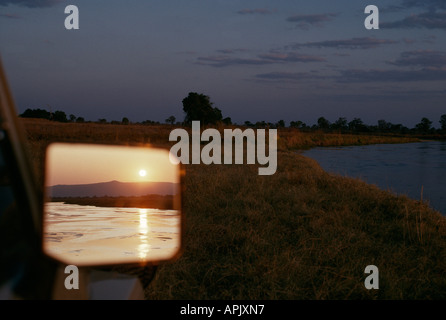 Sunset over the Mwaleshi river in North Luangwa National Park, Zambia. - Stock Photo