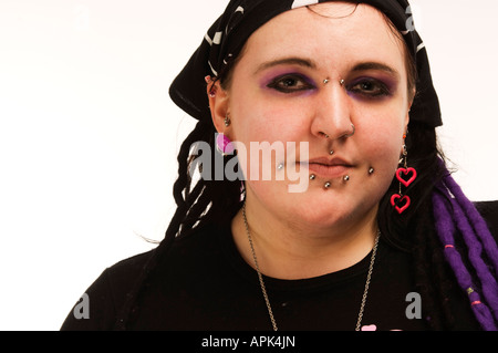 young fat punk goth welsh woman: she has multiple facial piercings UK - Stock Photo