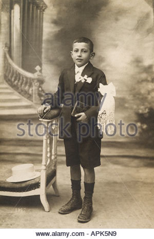 young boy posing to commemorate his first holy communion 1920s - Stock Photo