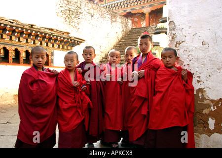 Bhutan Paro Festival Tsechu Young monks in the Dzong - Stock Photo