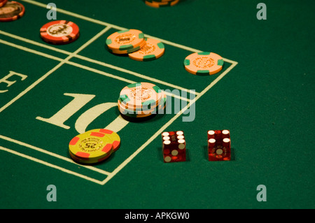 Dice and chips on a craps table in Las Vegas Nevada Caesars Palace and Casino - Stock Photo