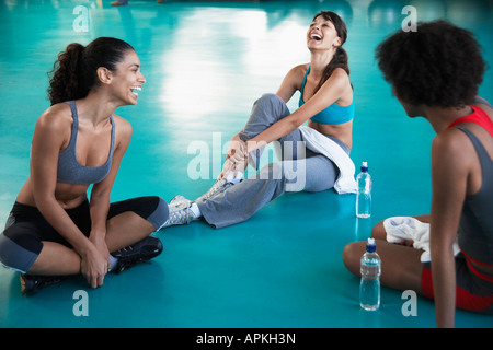 Young women in sports clothing laughing - Stock Photo
