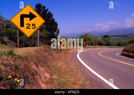 Speed Limit Road Sign warning Drivers of Sharp Right Curve along Pacific Coast Highway 1, California, USA - Stock Photo
