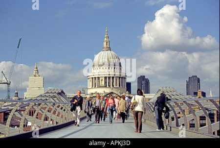 St Pauls Cathedral Contrasts With The New Millennium Bridge In London The Capital England - Stock Photo