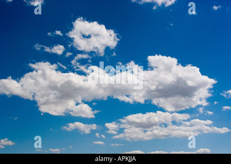 Blue Sky Fluffy white Clouds over Grand Canyon Arizona AZ - Stock Photo