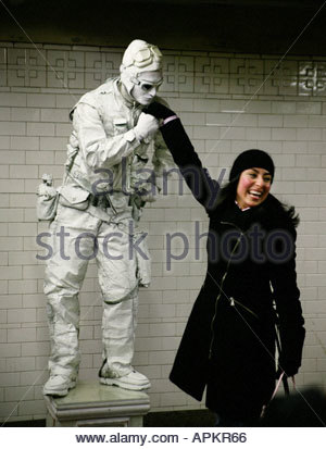 Tourist and entertainer in subway station. (NYC, New York, USA) - Stock Photo