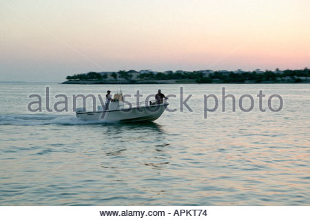 Speeding fishing boat. - Stock Photo