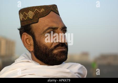 Portrait of a Punjabi man on Karachi's Clifton beach, Pakistan - Stock Photo