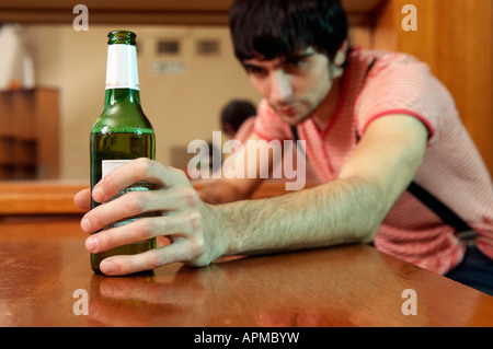 Man in a bar having a beer - Stock Photo