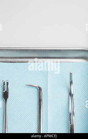 Medical instruments on tray (close-up) - Stock Photo