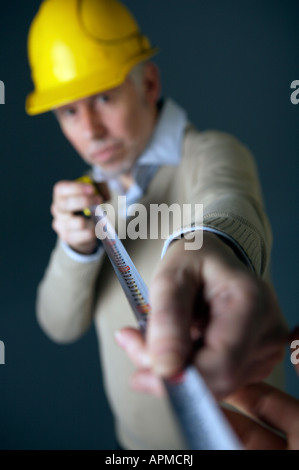 Architect holding metric tape - Stock Photo