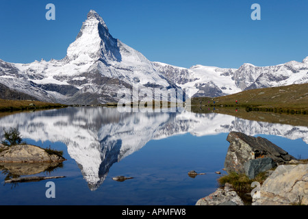 The majesty of the Matterhorn reflected in Stellisee - Stock Photo