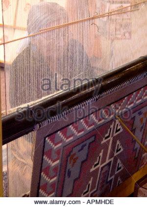 Mary H Begay Weaving a Navajo Rug Hubbell Trading Post National Historical Site Ganado Arizona - Stock Photo