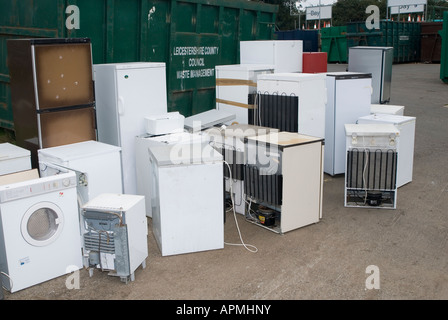 Kitchen appliances waiting to be recycled at a rubbish tip in the uk - Stock Photo