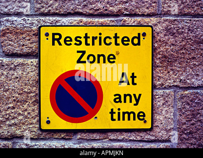 a restricted parking sign on a street in the uk - Stock Photo