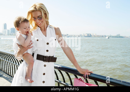 Mother with baby girl at waterfront, New York City, New York, USA - Stock Photo