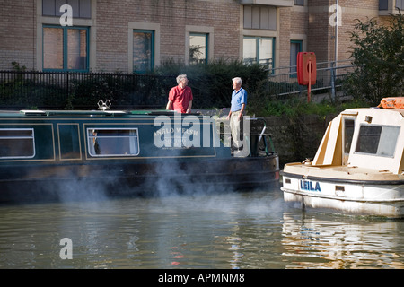 Air pollution from motor boat on the Thames at Oxford - Stock Photo