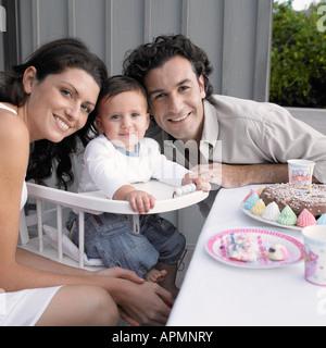Parents celebrating baby boy's (1-2) birthday (portrait) - Stock Photo
