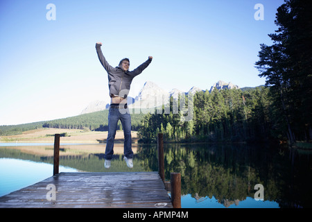 Teenage boy jumping on jetty, Cape Town, South Africa - Stock Photo