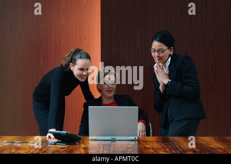 Businesswomen in boardroom - Stock Photo