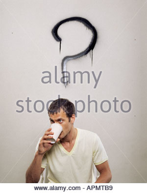 Man beside large question mark - Stock Photo