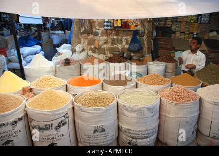 Man selling spices in the old souk in Sana'a, Yemen. - Stock Photo