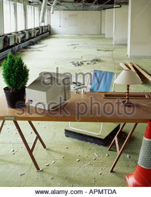 Desk in abandoned office - Stock Photo