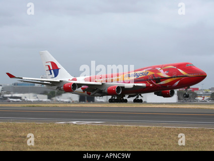 Malaysia Airlines Boeing 747-400 in special colours taking off from Sydney, Australia - Stock Photo