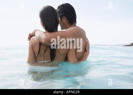 Young couple hugging in water, St. John, US Virgin Islands, USA - Stock Photo