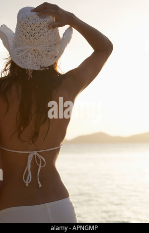 Young woman in beach attire looking at sea, St. John, US Virgin Islands, USA - Stock Photo