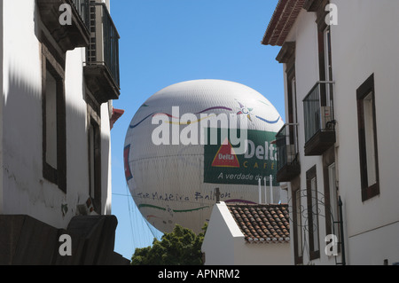 Touristic captive balloon at the harbour of Funchal, Madeira, Portugal, viewed from the old downtown - Stock Photo