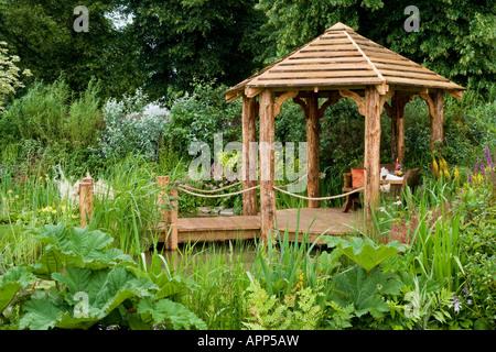rustic pergola gunnera primula hosta bog garden fairhaven water garden