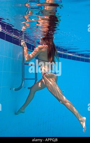 Woman In Bikini Climbing Ladder Underwater In Swimming Pool Stock Photo 9052702 Alamy