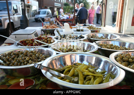 chilly's and olives on a market stall in bishops stortford town center - Stock Photo