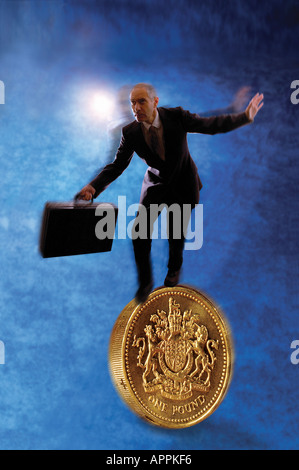 businessman walking on UK Pound coin - Stock Photo