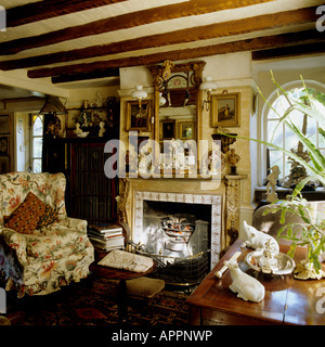 Cottage sitting room with beamed ceiling furnished in a traditional Victorian style - Stock Photo