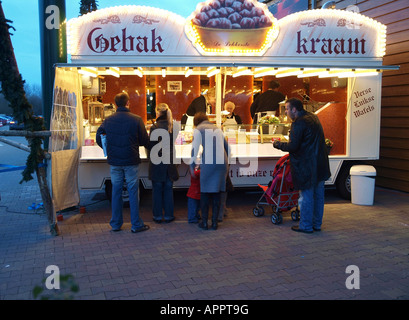 Market stall selling crepes around christmas time, Netherlands - Stock Photo