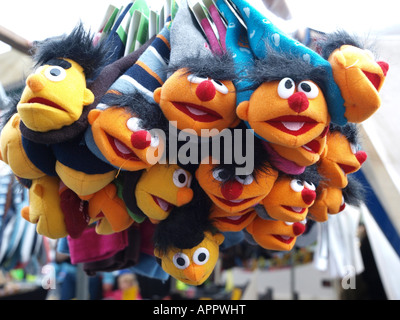 cuddly toys on display at market stall - Stock Photo